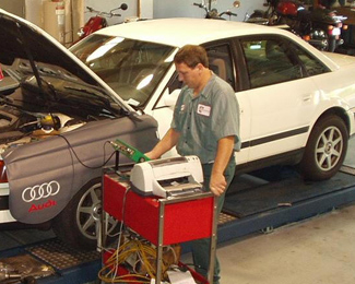 Mechanic Repairing an Audi in Our Alpharetta, GA Shop